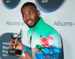 British rapper Dave poses with the Mercury Prize award for his album 'Psychodrama' after the awards ceremony in central London on September 19, 2019. Angst-filled rapper Dave scooped up Britain's coveted Mercury Prize on Thursday in a political-charged London finale that included a mouthy expletive shouted from stage at Prime Minister Boris Johnson. - Restricted to editorial use, no marketing no advertising campaigns - to illustrate the event as described in the caption.