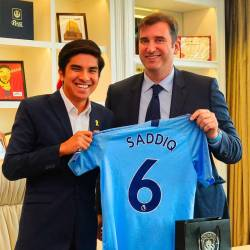 This handout photo from the Youth and Sports Ministry taken on May 23, 2019 and released on May 24, 2019 shows Youth and Sports Minister Syed Saddiq (L) and Manchester City's Spanish Chief Executive Officer Ferran Soriano posing for a picture in Putrajaya. - AFP