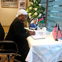 Filepix taken on May 29 shows Namibian High Commissioner to Malaysia Anne Namakau Mutelo signing a condolences book for the passing of Namibia's former Vice President Dr Nickey Iyambo on May 19.