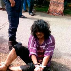 The suspected murderer after being apprehended by police. - Bernama
