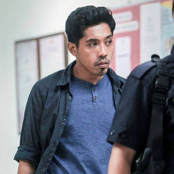 Marketing officer Muhammad Zikri Ibrahim, 29 (L) pleaded not guilty at the magistrate's court here over a charge of making insulting statements in connection with 15-year-old Nora Anne Quoirin's death last week. — BBXpress