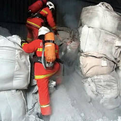 Firemen putting out the fire that engulfed 24 bags containing aluminium dross chemical waste at Jalan Perindustrian 5, Pontian Industrial Area, — Bernama