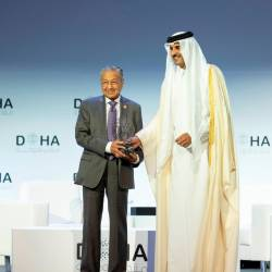 Qatar's Emir Sheikh Tamim bin Hamad al-Thani, honours Prime Minister Tun Dr Mahathir Mohamad during the opening of the Doha Forum, in Doha, Qatar, December 14, 2019. - Reuters