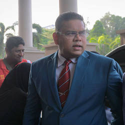 Lokman Adam wants to set aside contempt proceeding against him