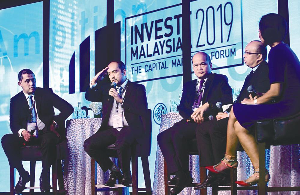 From left: Syed Hamadah, Tunku Alizakri, Shahril and PNB president & CEO Datuk Abdul Rahman Ahmad and moderator Haslinda Amin at Invest Malaysia 2019 yesterday. – Zulkifli Ersal/theSUN
