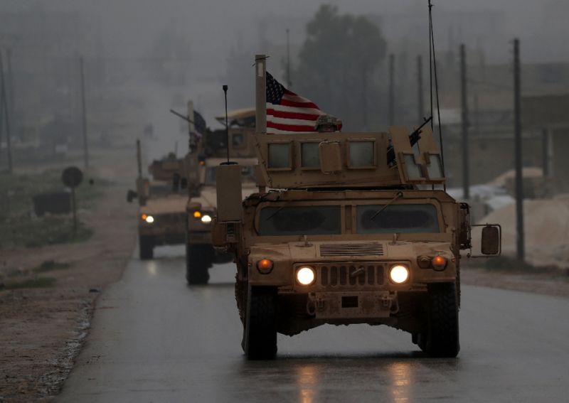 US military vehicles in the northern Syrian city of Manbij, which has long been held by the Kurdish-led Syrian Democratic Forces but is the target of a planned offensive by pro-Turkish forces. — AFP