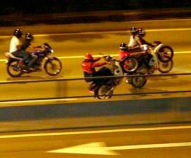 Illegal racing motorcyclists or popularly known as 'Mat rempit' in Malaysia, grazing the streets, dangering the lives of other road users.