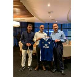 Owner of Cardiff City FC Tan Sri Vincent Tan with his guests from Sporting CP, Miguel Cal, the CEO (centre) and Nuno Fernando Cardoso, the Head of International Business Development.