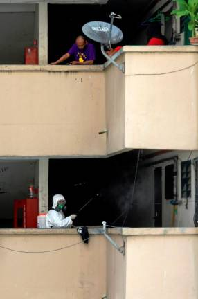 A worker disinfecting PPR lembah Subang One flats in effort to control the spread of the deadly Covid-19 virus. SUNPIX BY ASYRAF RASID