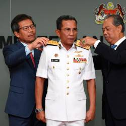 Home Minister Tan Sri Muhyiddin Yassin (R) and Home Ministry Secretary-General Datuk Seri Alwi Ibrahim (L) personally appoint and promote Maritime Admiral Datuk Mohd Zubil Mat Som as the new MMEA DG at the Home Ministry today. - Bernama