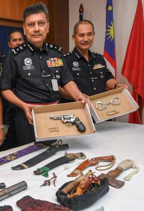Police detained two men and seized several weapons, a small quantity of syabu, about RM4,000 worth of pills and a car in Pasir Mas on Saturday.
