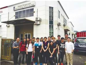 Head of Programme for Master of Information Systems Dr Wong Whee Yen (front row, fifth from left) with students at APR Electronic Services Sdn Bhd.