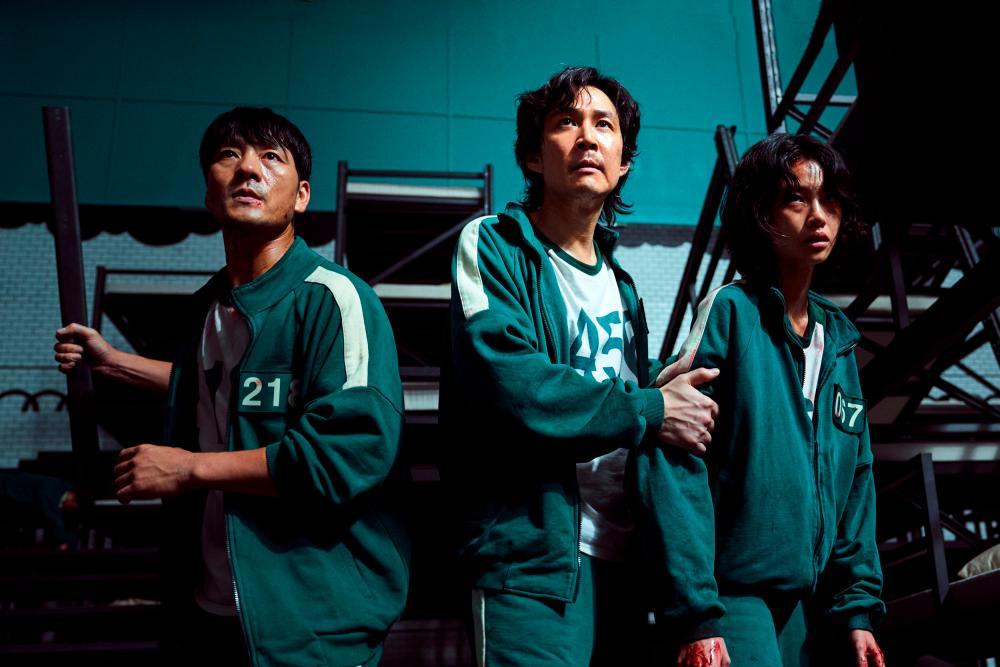 The final three (from left) Park Hae Soo as Cho Sang Woo, Lee Jung Jae as Seong Gi Hun, and Jung Ho Yeon as Kang Sae-byeok. — PHOTO COURTESY OF NETFLIX