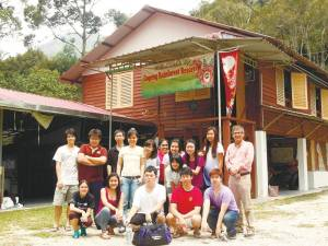 Lau (centre, in yellow) with her students during a field trip.