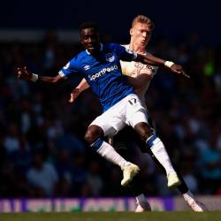 Everton's Senegalese midfielder Idrissa Gueye (L) is pressured by Manchester United's English midfielder Scott McTominay (R) during the English Premier League football match between Everton and Manchester United at Goodison Park in Liverpool, north west England on April 21, 2019. — AFP