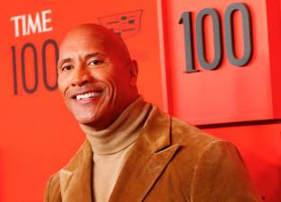 "FILE PHOTO: Dwayne ""The Rock"" Johnson poses upon arriving for the Time 100 Gala celebrating Time magazine's 100 most influential people in the world in New York, U.S., April 23, 2019. REUTERS/Andrew Kelly/File Photo"