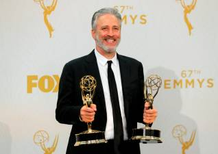 "FILE PHOTO: Jon Stewart holds his awards for Outstanding Writing For A Variety Series and Outstanding Variety Talk Series for Comedy Central's ""The Daily Show With Jon Stewart"" during the 67th Primetime Emmy Awards in Los Angeles, California September 20, 2015. REUTERS/Mike Blake/File Photo"