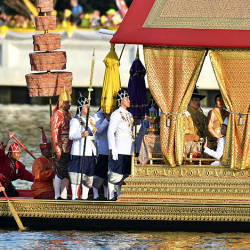 Thailand's King Maha Vajiralongkorn, his wife Queen Suthida and Prince Dipangkorn Rasmijoti sit at the Royal barge during the Royal Barge procession, in Bangkok on Dec 12, 2019 — AFP