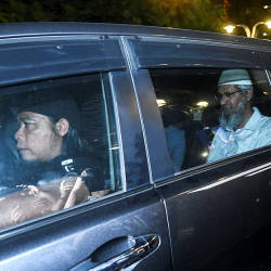 Filepix taken on Aug 16, of Zakir Naik leaving Bukit Aman following questioning.