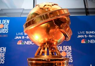 (FILES) In this file photo taken on December 09, 2019 Giant Golden Globe trophy are set on stage ahead of the 77th Annual Golden Globe Awards nominations announcement at the Beverly Hilton hotel in Beverly Hills. - AFP