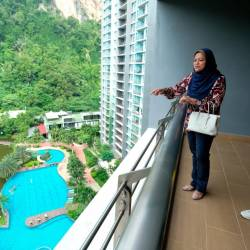 Perak State Housing, Local Government and Tourism Committee chairman Datuk Nolee Ashilin Mohd Radzi sees the view from the hotel balcony after opening the 'Green State' silver promotion ceremony at The Haven Resort yesterday. - Bernama
