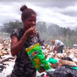 Screenshot of a Venezuelan girl eating after rummaging through a landfill in south Brazil.