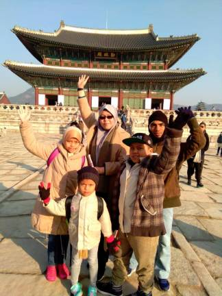 Mardiyah (wearing sunglasses) with her husband and children in Seoul.