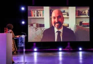 In this handout image released by the Booker Prize on November 19, 2020 Winning Author Douglas Stuart is seen on screen at The 2020 Booker Prize Awards Ceremony, broadcast in partnership with the BBC, at the Roundhouse in London. -AFP PHOTO / THEBOOKERPRIZES
