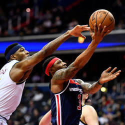 Washington Wizards guard Bradley Beal (3) shoots as Denver Nuggets forward Torrey Craig (3) defends during the second half at Capital One Arena. — Reuters