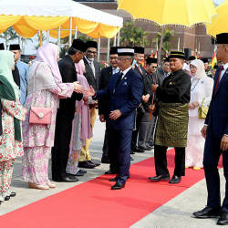 Yang di-Pertuan Agong Al-Sultan Abdullah Ri'ayatuddin Al-Mustafa Billah Shah shaking hands with cabinet ministers before departing to Brunei, at Kuala Lumpur International Airport today. — Bernama