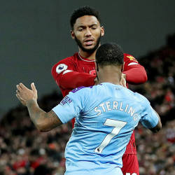 Liverpool's Joe Gomez and Manchester City's Raheem Sterling clash during their Premier League match at Anfield, Liverpool on Nov 10. — Reuters