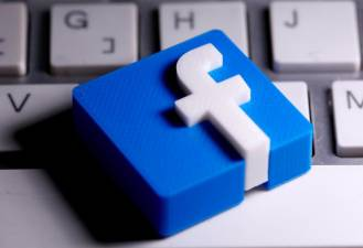 FILE PHOTO: A 3D-printed Facebook logo is seen placed on a keyboard in this illustration taken March 25, 2020. - Reuters