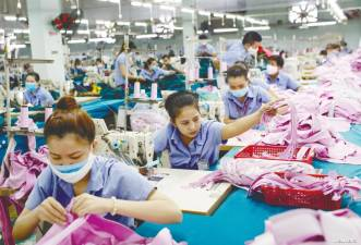 Workers on a production line in a garment factory in Hanoi, Vietnam. The Malaysian textile and apparel industry is expected to face competition from lower-cost producers in the RCEP region such as Vietnam. – REUTERSPIX