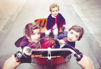 A cargo bike can be a practical solution for transporting kids. – IStock.com
