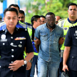Filepix of the Nigerian male suspect, at the Sepang magistrate's court, on May 17, 2019. — Bernama