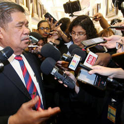 Filepix taken on Jul 15 shows Defence Minister Mohamad Sabu (left) at a press conference in parliament. — Sunpix by Zulkifli Ersal