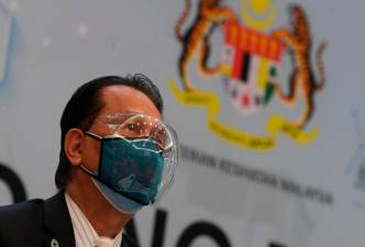 FILE PHOTO: People walk across London Bridge as the spread of the coronavirus disease (COVID-19) continues in London, Britain, December 15, 2020. REUTERS/Hannah McKay/File Photo