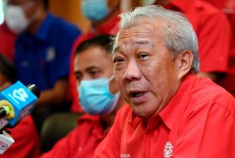 Sabah Umno chairman Datuk Seri Bung Moktar Radin speaks at a press conference after chairing the Umno Political and Liaison Bureau Meeting at the Sabah state Umno headquarters today. - Bernama
