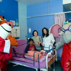 Lim (left) and Chew with the mascots and a young patient.