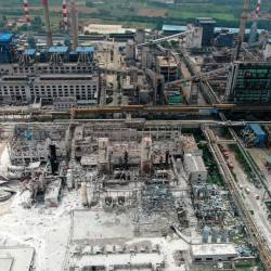 Damaged buildings are seen at the site of an explosion at the Henan Coal Gas Group factory in Yima city, in China's central Henan province on July 20, 2019. - AFP