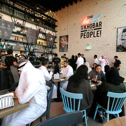 Women sit among men in a newly opened cafe in Khobar, Saudi Arabia, Aug 2, 2019 — Reuters