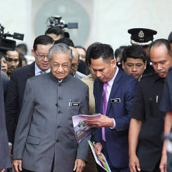 Prime Minister Tun Dr Mahathir Mohamad leaves after speaking to members of the press after the National Strategy for Financial Literacy launch event at the Sasana Kijang, Kuala Lumpur on July 23. — Sunpix by Norman Hiu