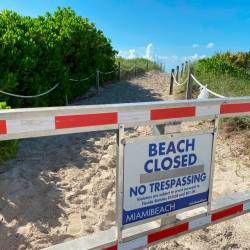 A sign informing about South Beach closure, to prevent the spread of the coronavirus disease (Covid-19), is seen ahead of the Fourth of July weekend, in Miami Beach, Florida, US, July 3, 2020. — Reuters