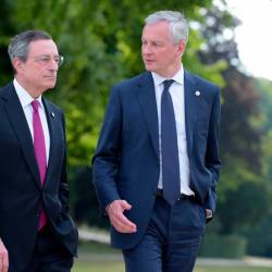 French Finance and Economy Minister Bruno Le Maire (R) and European Central Bank President Mario Draghi (L) walk in the garden during the G7 Finance Ministers and Central Bank Governors' meeting in Chantilly on July 17, 2019, as part of preparations for the summit in Biarritz. — AFP