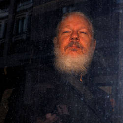 WikiLeaks founder Julian Assange is seen as he leaves a police station in London, Britain April 11, 2019. - Reuters