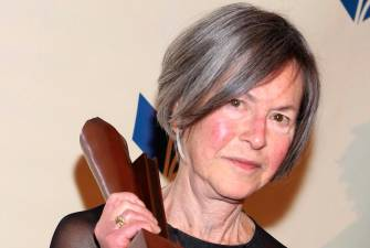 "FILES) This file photo taken on November 19, 2014 shows Louise Gluck attending the 2014 National Book Awards in New York City. The Nobel Literature Prize went Thursday, October 8, 2020 to American poet Louise Gluck, the jury at the Swedish Academy said. Gluck was honoured ""for her unmistakable poetic voice that with austere beauty makes individual existence universal,"" the Academy said. / AFP / GETTY IMAGES NORTH AMERICA / Robin Marchant / ALTERNATIVE CROP"