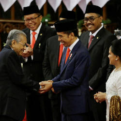 Indonesian President Joko Widodo shakes hands with Prime Minister Mahathir Mohamad after his presidential inauguration for the second term, at the House of Representatives building in Jakarta, Indonesia, Oct 20, 2019. — Reuters