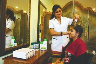 A beauty therapist attending to a customer.