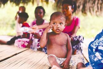 A Bateq child rests in a hut in Kuala Kroh after treatment on Tuesday. – Bernamapix
