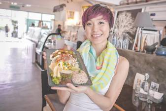 Goh holds up a plate of delicious Vegan food from Sala. –ADIB RAWI /THESUN